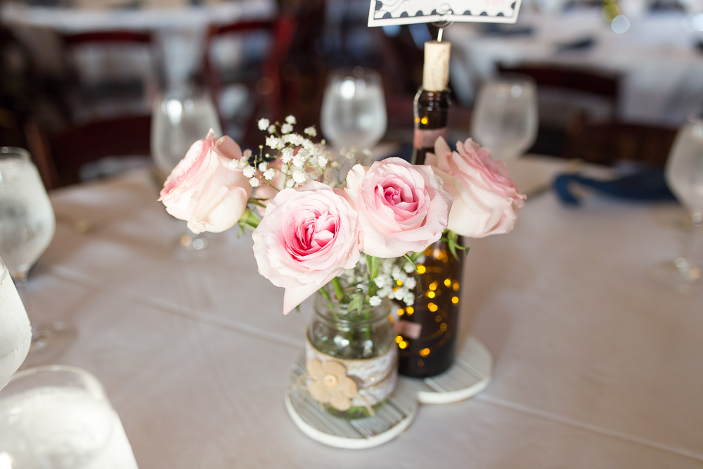 Wine bottle and mason jar centerpieces at Bull Run Winery Wedding