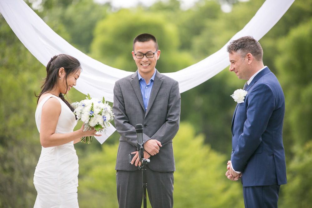 Reading vows during their wedding ceremony | Photojournalism style | Megan Rei Photography