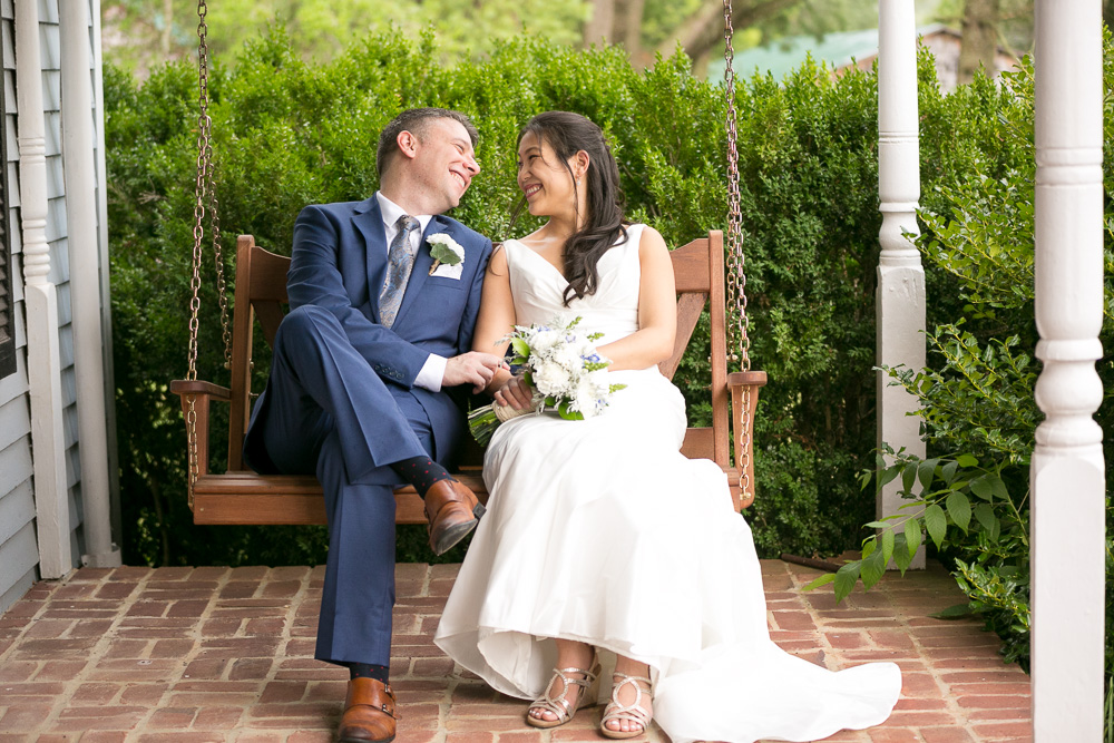 Bride and groom on the porch swing at their Culpeper wedding
