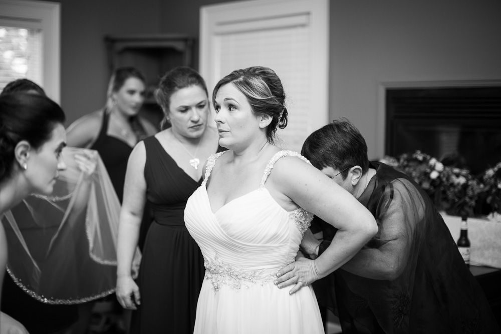 Putting on the wedding dress in the bridal suite at Mountain Run Winery | Documentary Northern Virginia Wedding Photographer