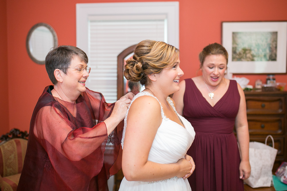 Bride putting on her dress | Candid Wedding Photographer in Northern Virginia| Megan Rei Photography