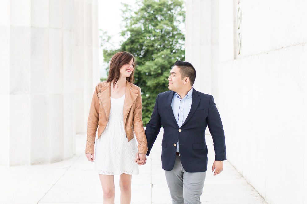 Walking through the columns of the Lincoln Memorial | Washington DC Engagement Photos