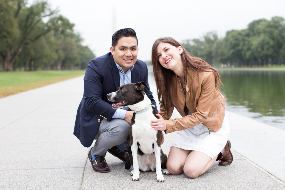 Engaged couple posing with their dog by the Reflecting Pool | Washington DC Pet Photography | Best places for engagement pictures in DC