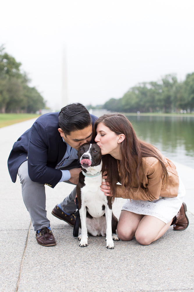 Giving kisses to their puppy | Best Washington DC Engagement Photos | Reflecting Pool and Washington Monument