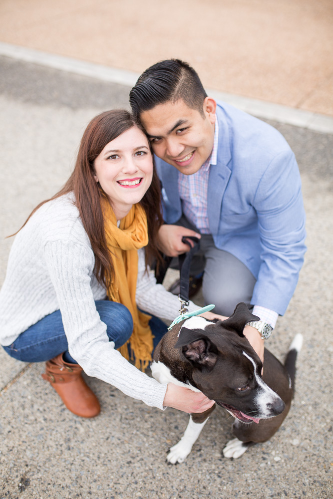 Smiling up at the camera while dog is distracted | DC Engagement Photography