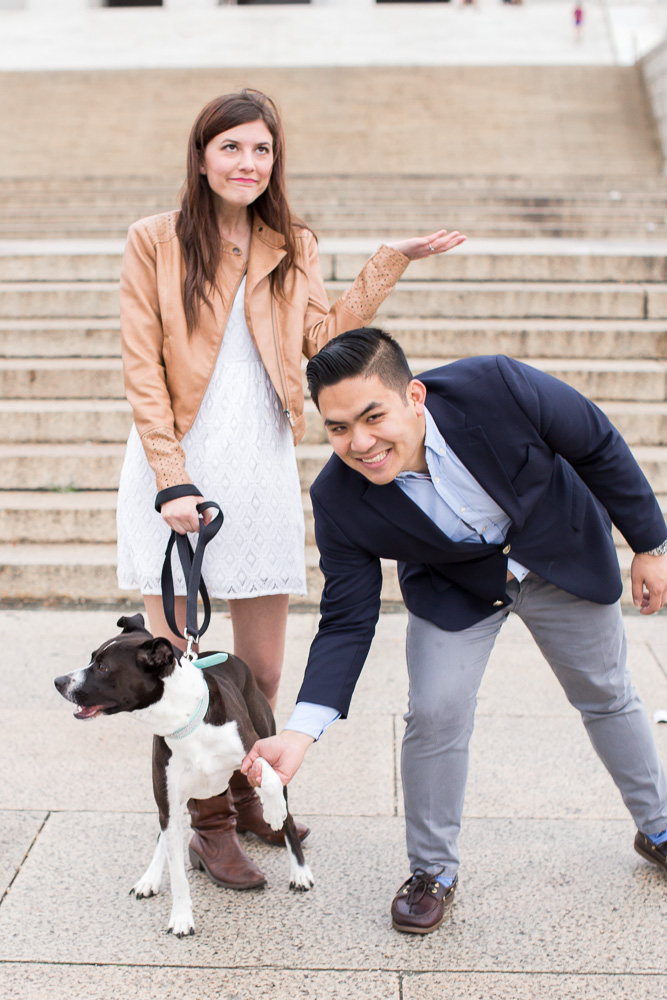 Couple goofing around with their dog during their engagement session
