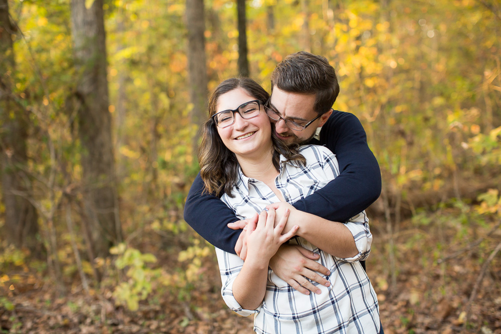 Candid photo of couple hugging during their engagement photos in Fauquier County, Virginia