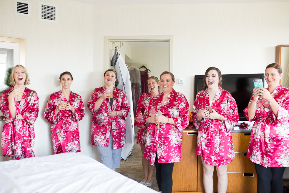 Bridesmaids laughing while watching the bride read her letter from the groom | Candid Wedding Photographer in Northern Virginia | Megan Rei Photography