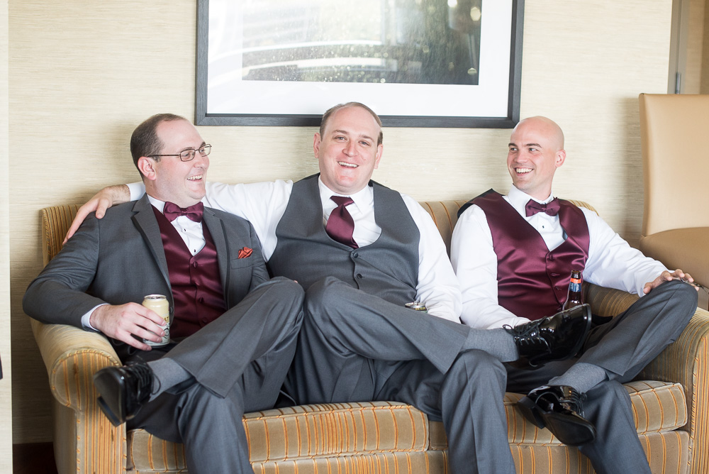 Groom hanging out with his groomsmen at the Westin Washington Dulles | Herndon, Virginia Wedding Photography