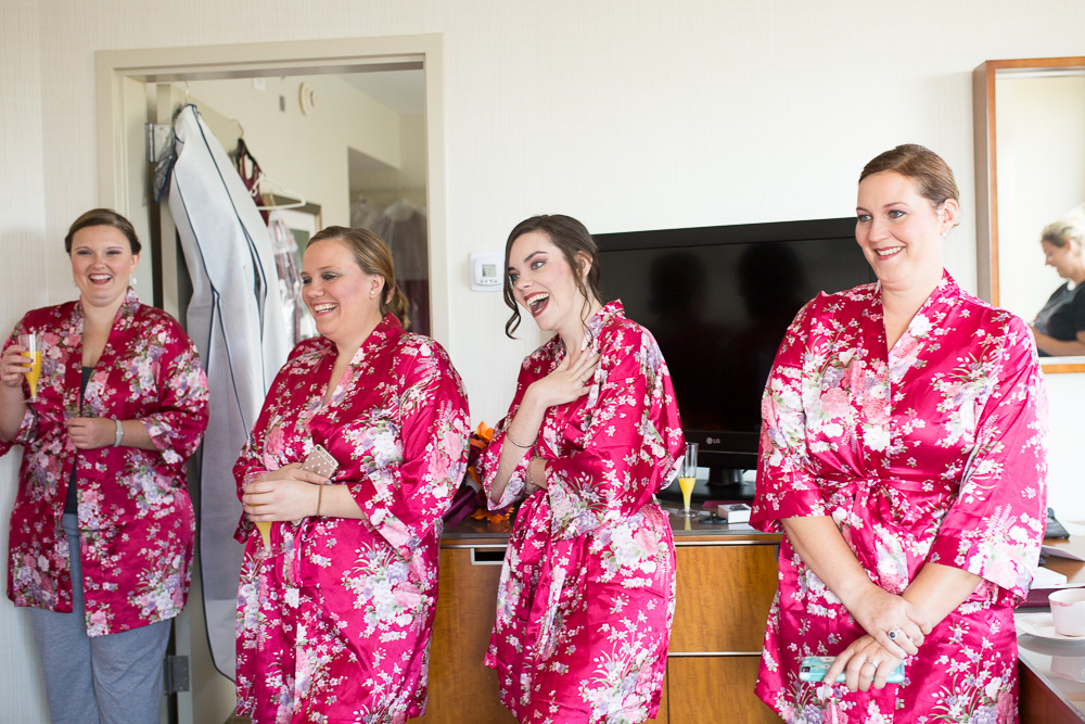 Candid laughter photo of the bridesmaids while getting ready for the wedding day | Northern Virginia Candid Wedding Photography