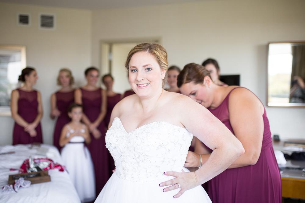 Bride putting on her wedding dress at the Westin Dulles Hotel in Herndon, Virginia | Herndon, Virginia Wedding Photographer