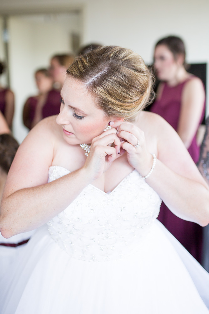 Bride putting in her earrings | Documentary Wedding Photography