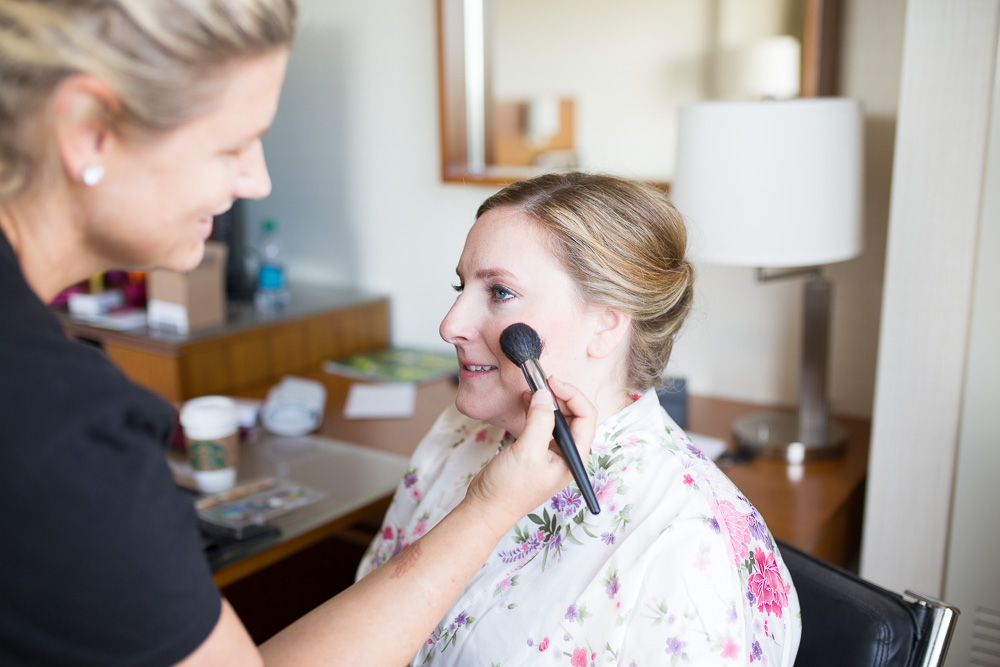 Bride getting ready with makeup done by Makeup by Michelle L | Westin Washington Dulles Hotel Room