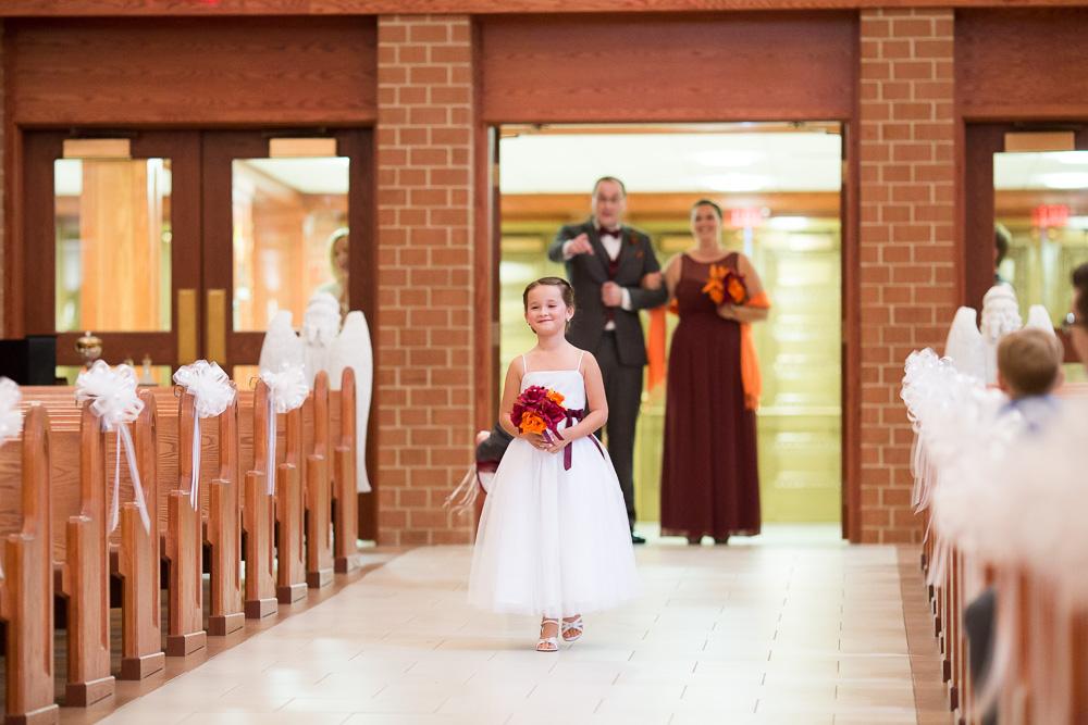 Flower girl walking down the aisle at Saint Theresa Catholic Church in Northern Virginia | Ashburn Virginia Wedding Ceremony