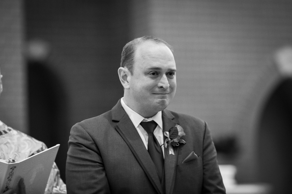 An emotional groom crying as the bride walks down the aisle | St. Theresa Parish Wedding