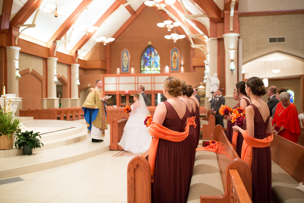 Bridesmaids watching the wedding ceremony at Saint Theresa's Catholic Church