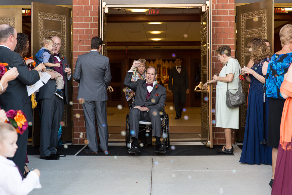 Father of the groom exiting the church in Ashburn Virginia