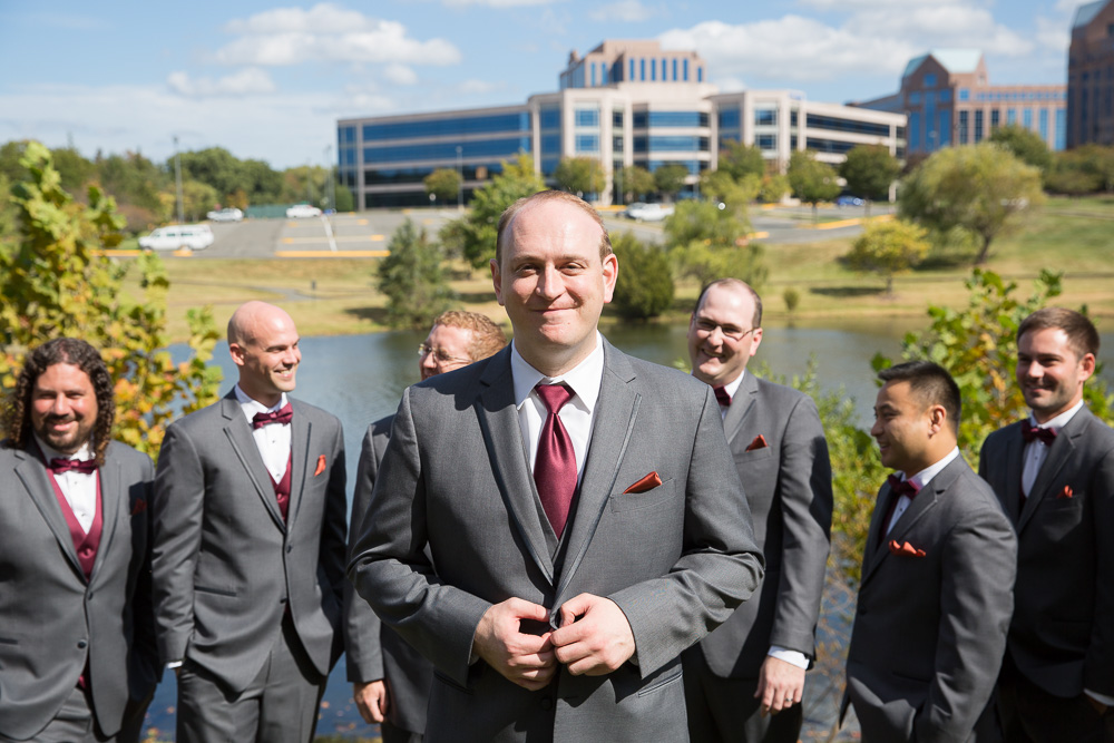 Groomsmen photo in front of the lake at the Westin Dulles Hotel