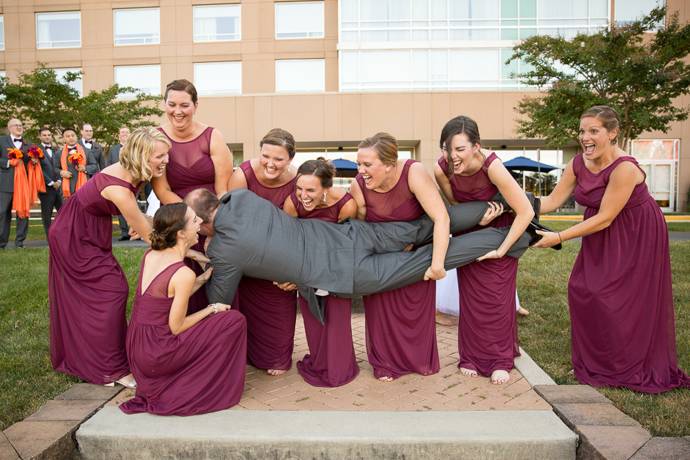 Fun picture of bridesmaids trying to hold the groom | Candid Northern Virginia Photographer | Megan Rei Photography
