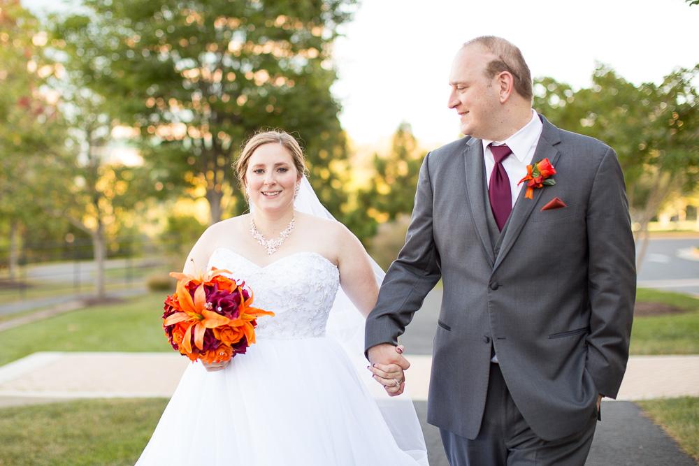 Bride and groom walking hand-in-hand on their wedding day | Herndon, Virginia Wedding | Northern Virginia Wedding Photographer
