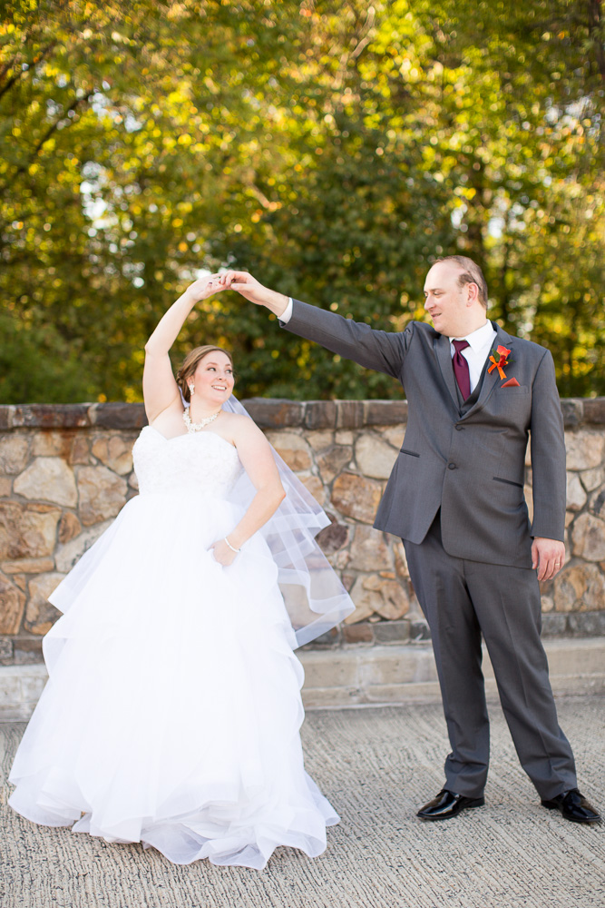 Wedding couple dancing on the stone bridge at the Westin Washington Dulles Airport Hotel | Herndon, Virginia Wedding Venue