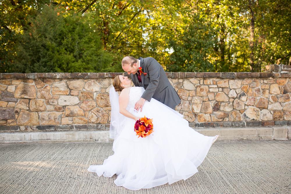When I dip, you dip, we dip | Wedding couple on the stone bridge at Westin Dulles