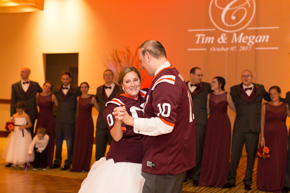 Virginia Tech Hokie maroon and orange wedding | Personalized wedding monogram and uplighting from Dominion Wedding Entertainment