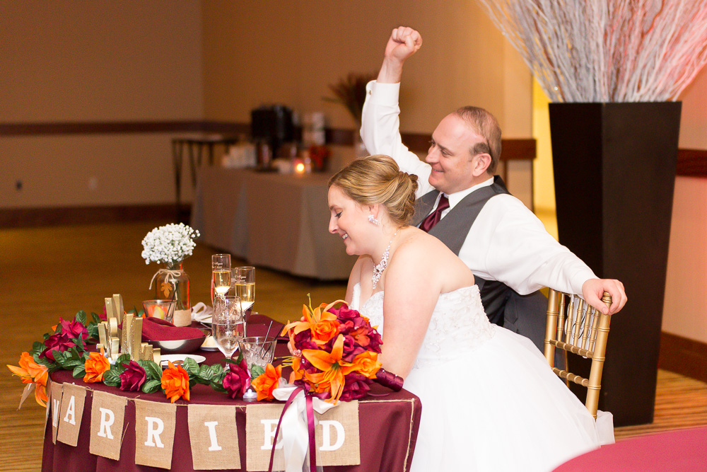 Candid photo of bride and groom while listening to the toasts | Northern Virginia Wedding Photography at the Westin Washington Dulles | Megan Rei Photography