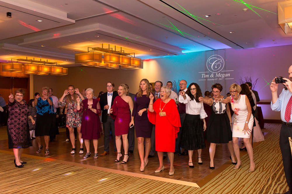 Packed wedding dance floor at the Westin Washington Dulles with colorful uplighting| Best Northern Virginia Wedding Reception Venues