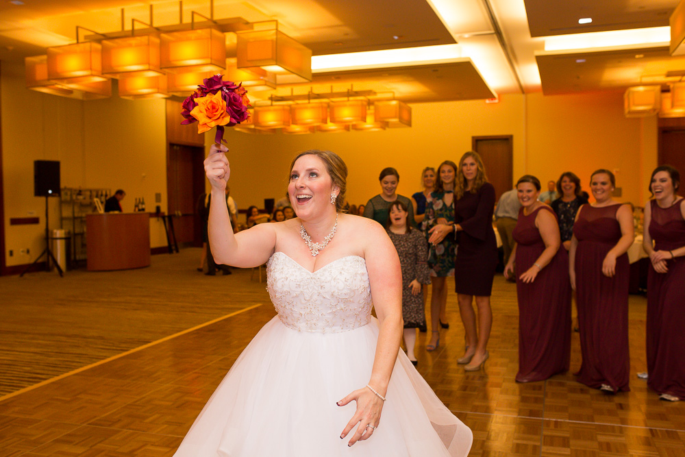 Bouquet toss at a Virginia Tech Hokies Wedding in Northern Virginia | Maroon and orange wedding colors