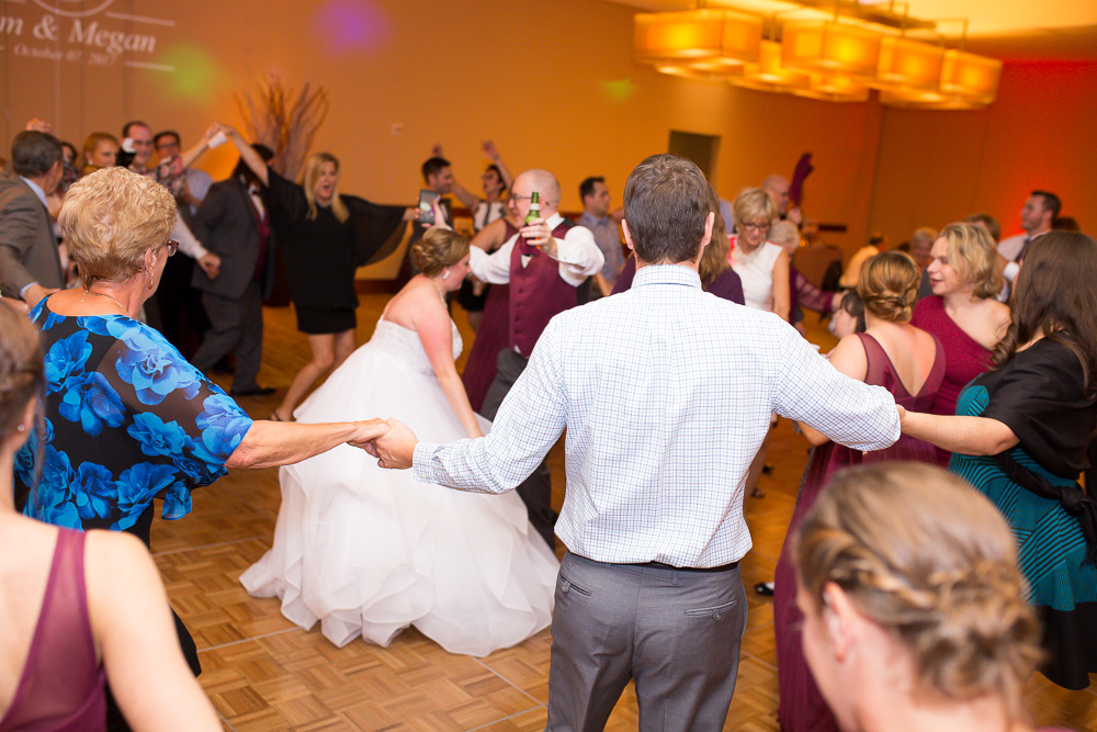 Candid and fun dancing picture from Virginia Tech Hokies wedding