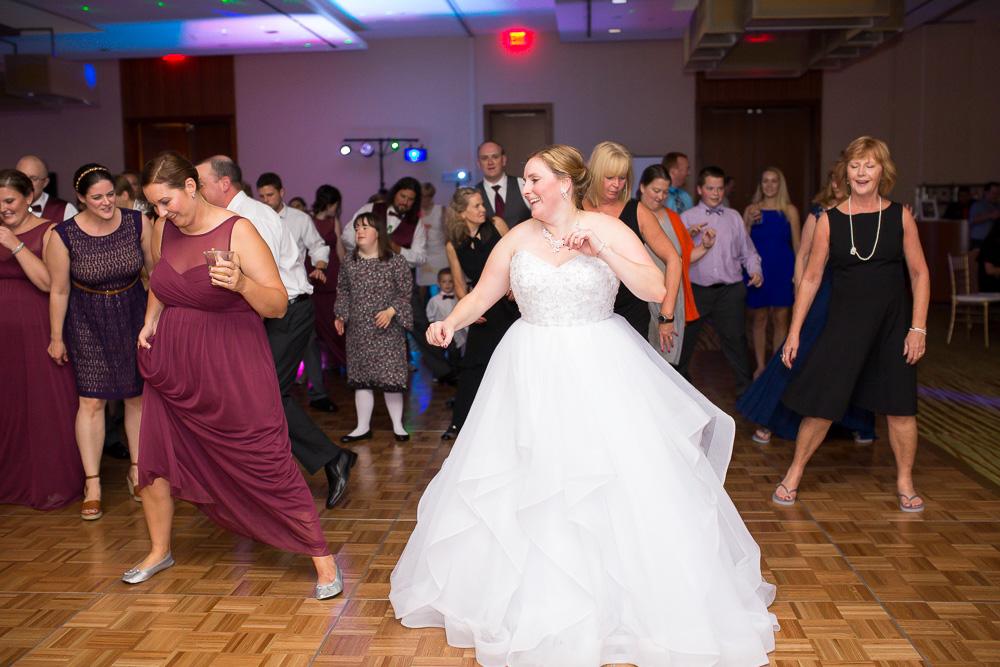 Bride having fun on the dance floor on her wedding day | Candid Wedding Photographer in Northern Virginia