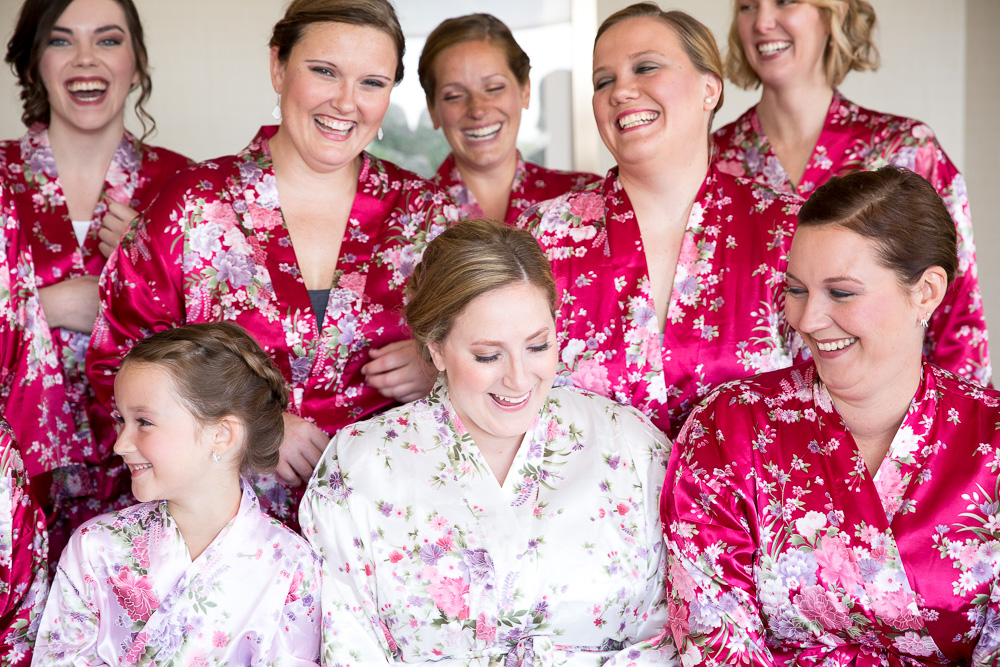 Bride and bridesmaids in matching robes at the Westin Washington Dulles Airport Hotel | Candid getting ready photos