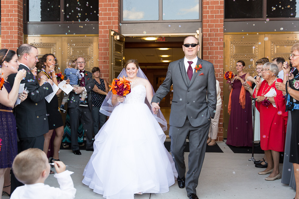 Bride and groom exiting the church with bubbles | Saint Theresa Church Wedding in Ashburn, Virginia