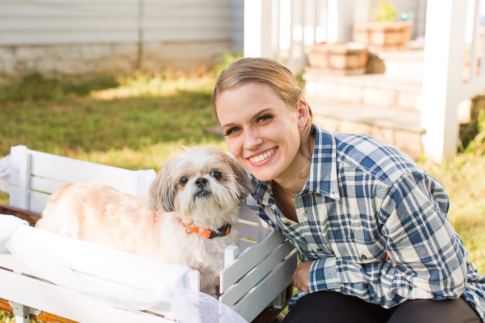 Bride posing with her wedding dog at Mountain Run Winery | Fall Wedding in Culpeper, Virginia