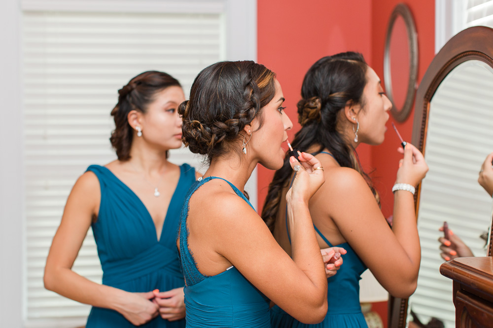 Bridesmaids putting on lipstick in the bridal suite at Mountain Run Winery | Culpeper Documentary Wedding Photographer
