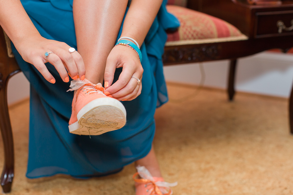 Bridesmaid tying her sneakers