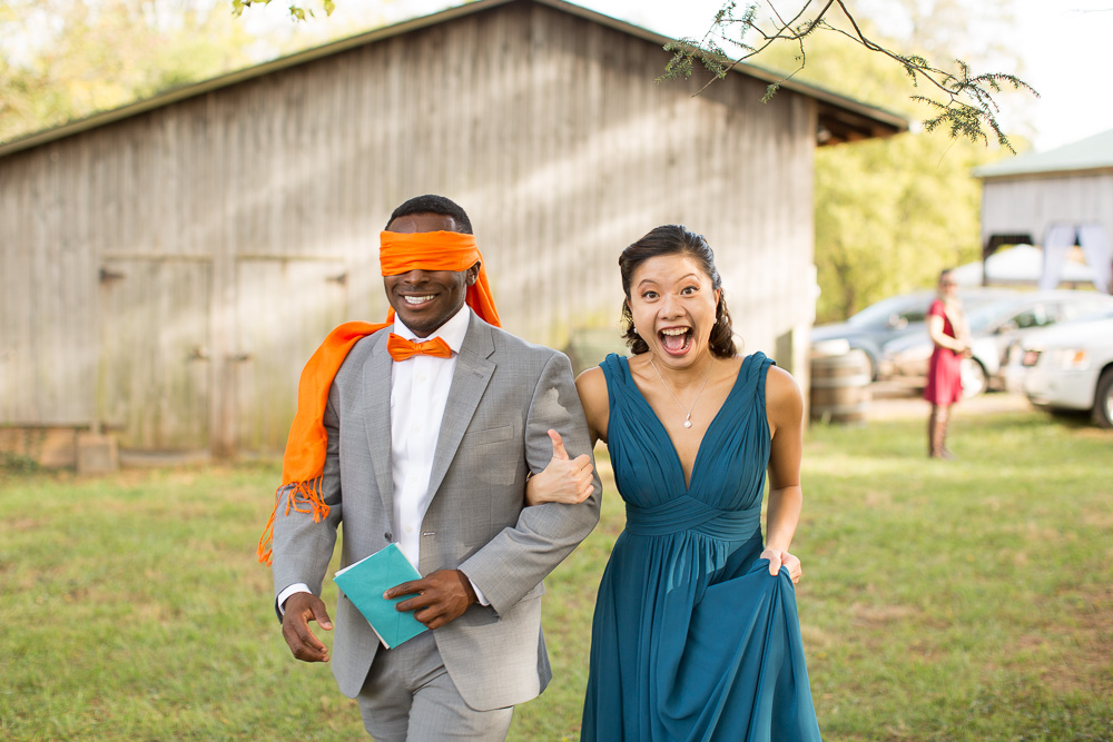 Groom blindfolded and heading to the First Look at Mountain Run Winery | Culpeper Wedding Photographer