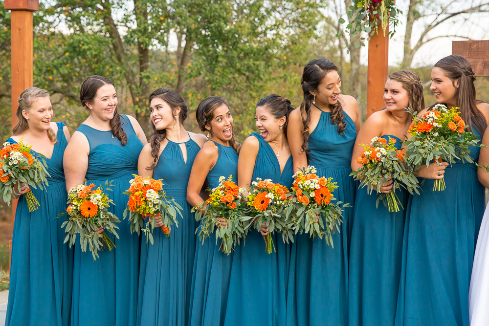 TTeal bridesmaid dresses from Azazie | Orange bouquets from Melanie's Florist