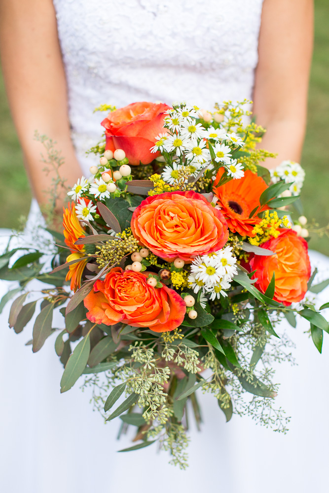 Beautiful orange bridal bouquet for fall wedding | Melanie's Florist in Haymarket, Virginia