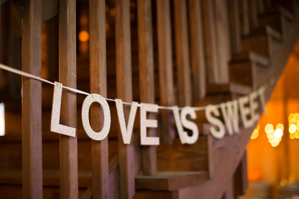 """Love is sweet"" sign for dessert table at Mountain Run Winery 
