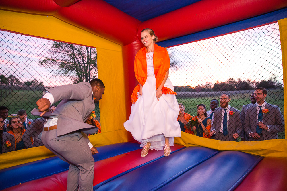Wedding photos in the moon bounce | Fun Wedding Photographer in Northern Virginia