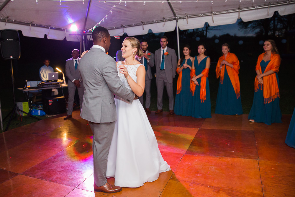 Bride and groom first dance under the tent