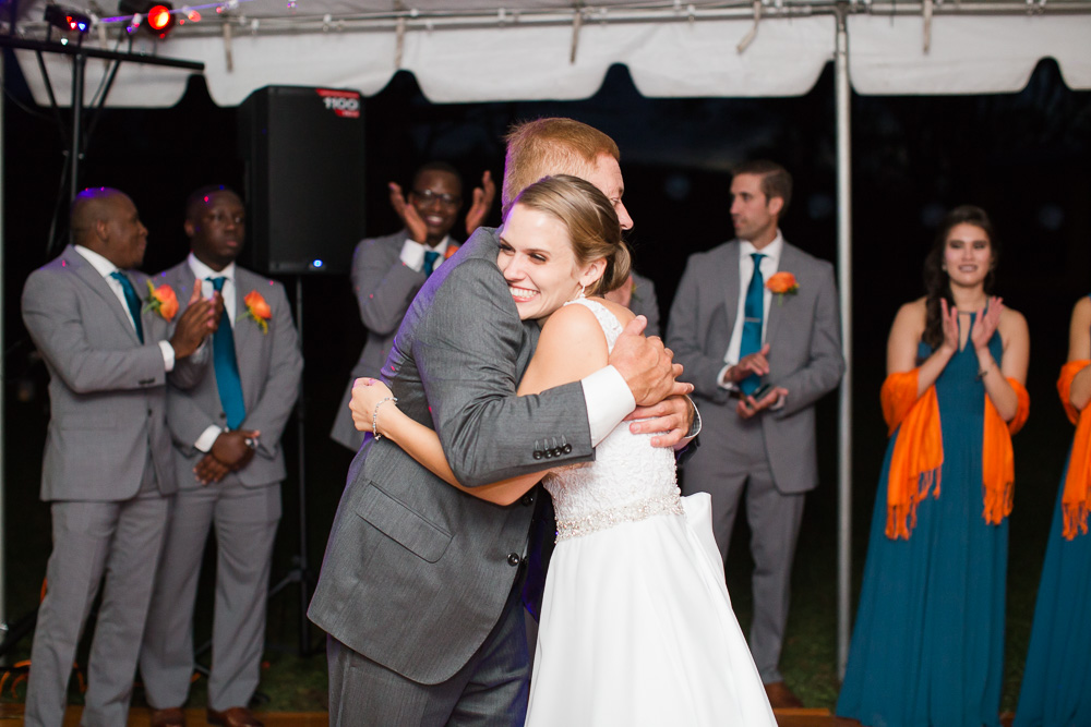 Bride hugging her dad during the father-daughter dance at her wedding | Candid Wedding Photography in Culpeper, VA