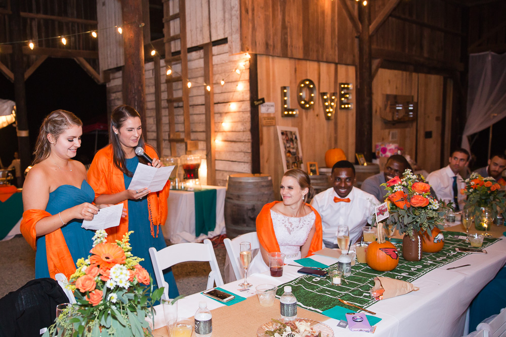 Bridesmaids giving a toast under the barn at Mountain Run Winery | Best Barn Wedding Venues in Culpeper, Virginia