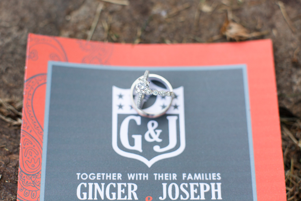 Weddings rings with football-themed wedding invitation