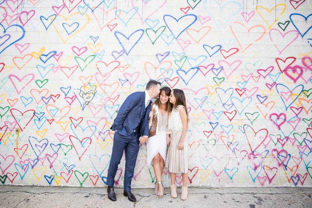 Candid wedding photos at Union Market heart wall | Washington DC Wedding Photography | Megan Rei Photography