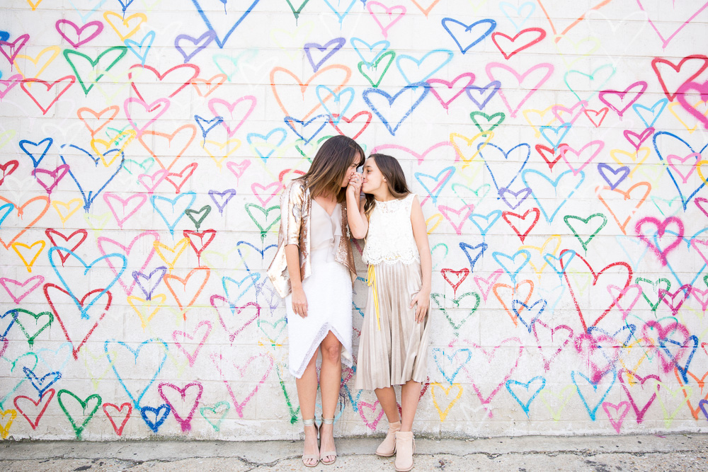 Bride and her daughter at the Union Market heart wall mural | Documentary Wedding Photographer in Washington DC | Megan Rei Photography