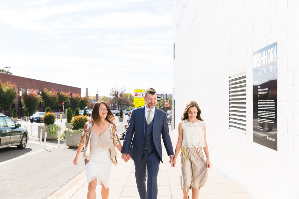 Walking down the street at Union Market | Photojournalistic Wedding Photography