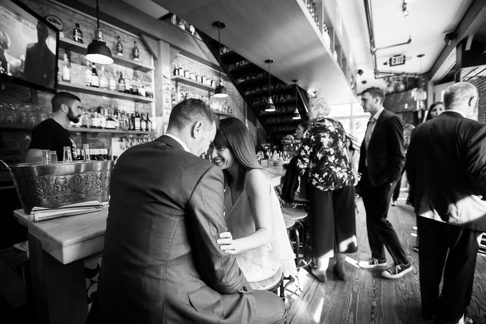 Documentary style photos at a surprise wedding at Lupo Verde